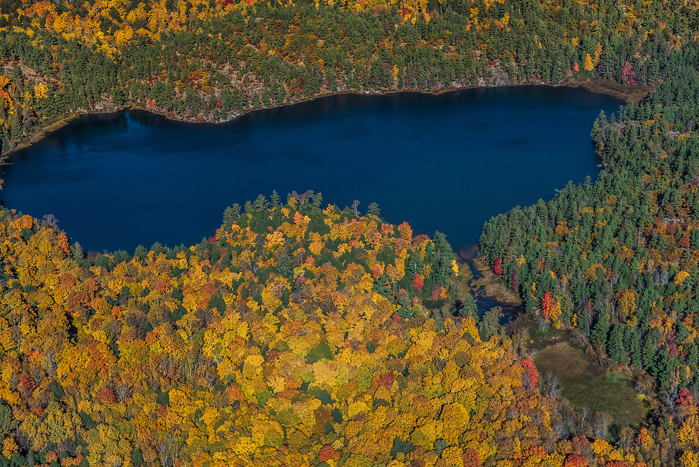 Aerial photography of fall color among the rugged highlands of Marquette County near Big Bay, Michigan.