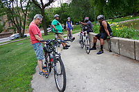 """The South Side Critical Mass sponsors bike rides every first Friday of the month starting at Nichols Park and following a different route each time. This past Friday, July 5th, 2019 they took a 10 mile ride through the south side of Chicago.<br /> <br /> Please 'Like' """"Spencer Bibbs Photography"""" on Facebook.<br /> <br /> Please leave a review for Spencer Bibbs Photography on Yelp.<br /> <br /> Please check me out on Twitter under Spencer Bibbs Photography.<br /> <br /> All rights to this photo are owned by Spencer Bibbs of Spencer Bibbs Photography and may only be used in any way shape or form, whole or in part with written permission by the owner of the photo, Spencer Bibbs.<br /> <br /> For all of your photography needs, please contact Spencer Bibbs at 773-895-4744. I can also be reached in the following ways:<br /> <br /> Website – www.spbdigitalconcepts.photoshelter.com<br /> <br /> Text - Text """"Spencer Bibbs"""" to 72727<br /> <br /> Email – spencerbibbsphotography@yahoo.com<br /> <br /> #SpencerBibbsPhotography <br /> #HydePark <br /> #Community <br /> #Neighborhood<br /> #CanonUSA"""