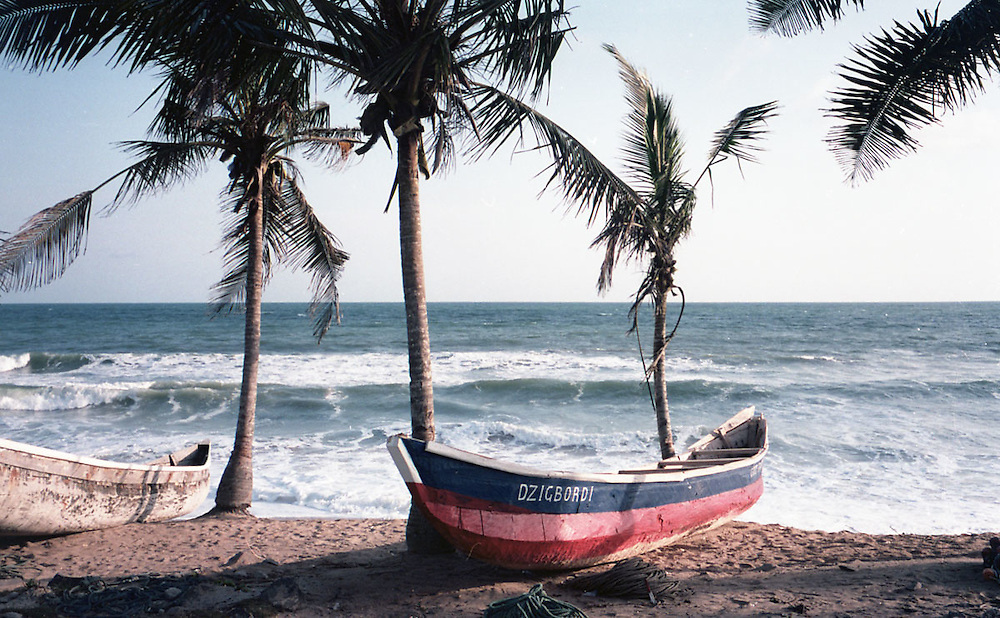 Fishing boat laying on a sandy beach on the way to Takoradi, Ghana 2011