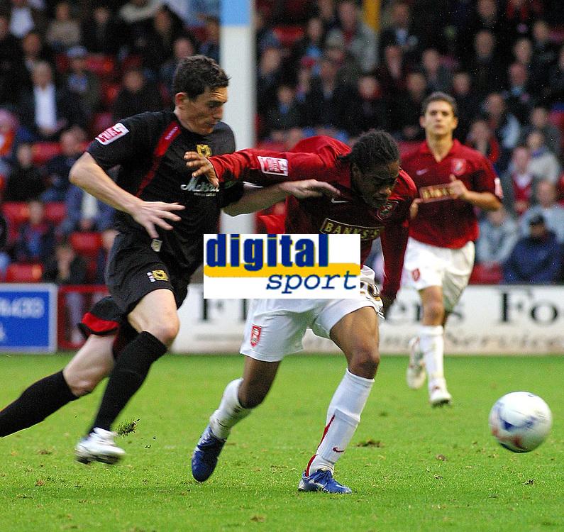 Photo: Dave Linney.<br />Walsall v Milton Keynes Dons. Coca Cola League 2. 28/10/2006.Walsalls' .Ishmel  Demontagnac(R) heads goalwards past  Keith Andrews