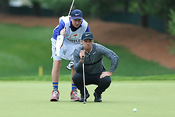 June 23, 2018 - Cromwell, Connecticut, United States - Paul Casey (R) and his caddie line up a putt on the 8th green during the third round of the Travelers Championship at TPC River Highlands. (Credit Image: © Debby Wong via ZUMA Wire)