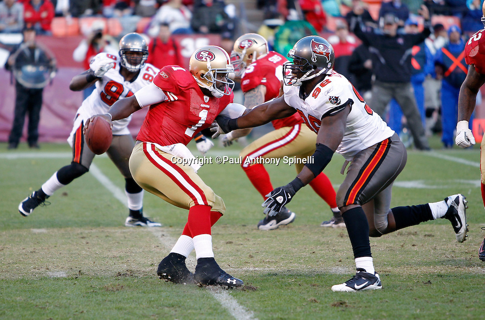 San Francisco 49ers quarterback Troy Smith (1) gets pressured on a pass play by Tampa Bay Buccaneers defensive end Tim Crowder (96) during the NFL week 11 football game against the Tampa Bay Buccaneers on Sunday, November 21, 2010 in San Francisco, California. The Bucs won the game 21-0. (©Paul Anthony Spinelli)
