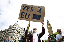 © Licensed to London News Pictures. 25/06/2016. London, UK. Pro-European campaigners protest against the result of the EU referendum outside Parliament Square, London on Saturday, 25 June 2016. The referendum was won by the leave campaign and caused Prime Minister David Cameron to resign. Photo credit: Tolga Akmen/LNP