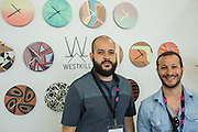 Joe Silver and Justin Horowitz, the two principals of Westkill, in front of some of their wall clocks, which feature designs silkscreened onto wood. BklynDesigns is part of NYCxDesign, a week-long design festival in New York City.