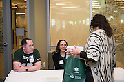 Dan Pittman, the Public Relations Manager, left, and Katie Quaranta, a communications specialist, right, both for University Communications and Marketing, at the Campus Communicator Network Expo in Nelson Commons on Wednesday, May 11, 2016. © Ohio University / Photo by Kaitlin Owens