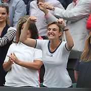 LONDON, ENGLAND - JULY 15:  Conchita Martinez, coach of Garbine Muguruza of Spain, (left, partially hidden), celebrates her victory while in the family box during the Ladies Singles final against Venus Williams of The United States in the Wimbledon Lawn Tennis Championships at the All England Lawn Tennis and Croquet Club at Wimbledon on July 15, 2017 in London, England. (Photo by Tim Clayton/Corbis via Getty Images)