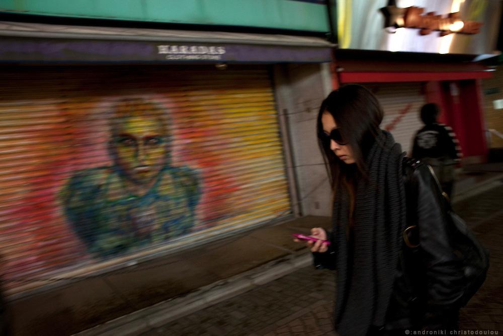 Girl with mobile phone on Takeshita-dori in Harajuku