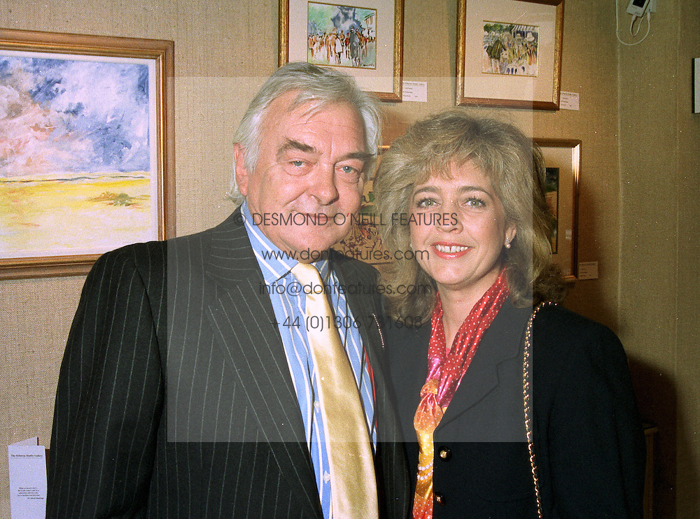 Actor DAVID HEMMINGS and his constant companion MRS LUCY WILLIAMS at an exhibition in London on 20th May 1997.LYJ 4