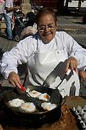 Logrono (Spain) 19/09/2007 - 51° Fiesta de la Vendimia Riojana 2007. Semana Gastronomica. Degustacion de Huevo fritos con pimientos (Pena Aster) and Choricillo y panceta (Pena Logrono) - Plaza del Mercado