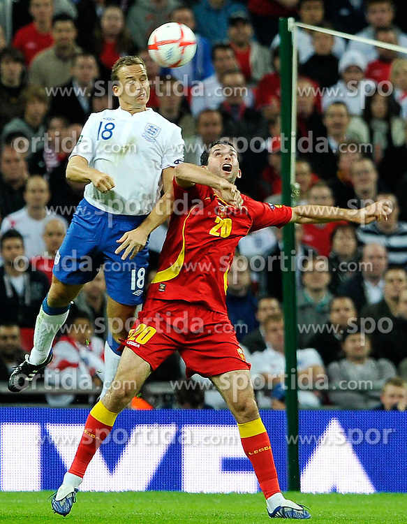 12.10.2010, Wembley Stadium, London, ENG, UEFA 2012 Qualifier, England vs Montenegro, im Bild Kevin Davies of England gets the better of Miodrag Dzudovic of Montenegro, EXPA Pictures © 2010, PhotoCredit: EXPA/ IPS/ Sean Ryan *** ATTENTION *** UK AND FRANCE OUT!