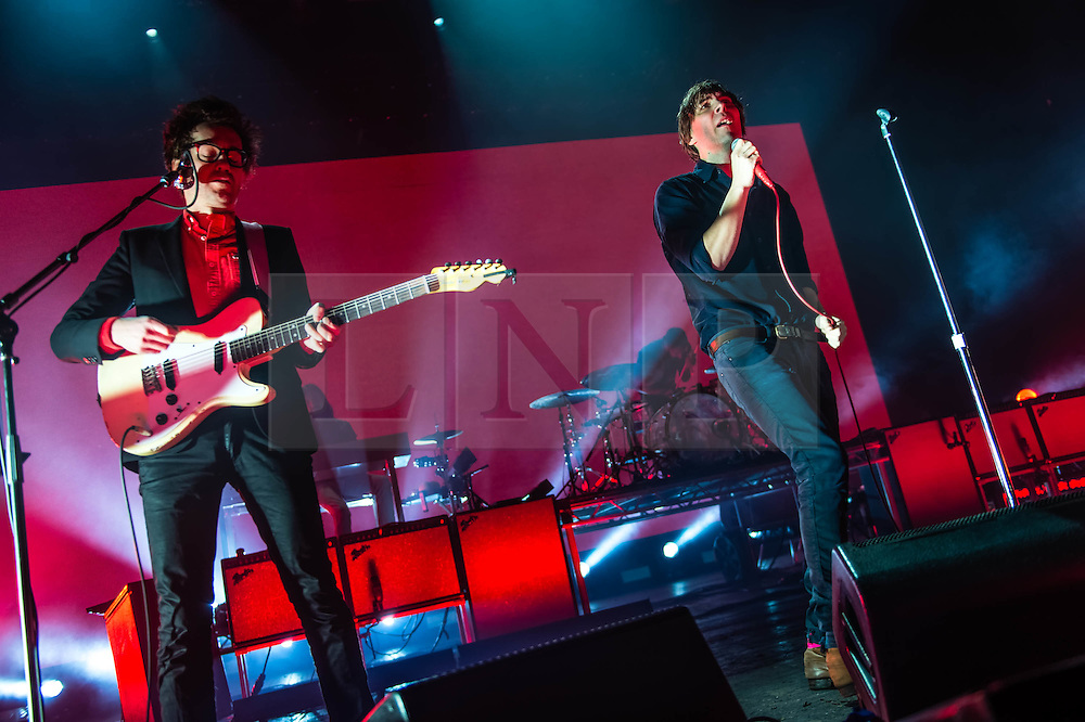 © Licensed to London News Pictures. 12/02/2014. London, UK.   Phoenix performing live at Brixton Academy.   In this picture - Laurent Brancowitz (left), Thomas Mars (right).  Phoenix is a french alternative rock band comprising of members Thomas Mars (vocals), Deck D'Arcy (Bass,Keyboards), Laurent Brancowitz (guitar, keyboards), Christian Mazzalai (guitar).  Photo credit : Richard Isaac/LNP