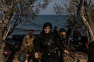 An Iraqi woman walks from a  beach on the island of Lesvos, Greece where she arrived in a rubber raft from the North coast of Turkey on November 5, 2015.
