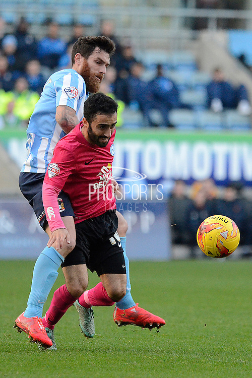 Peterborough United midfielder Erhun Oztumer skips away from Coventry City midfielder Romain Vincelot during the Sky Bet League 1 match between Coventry City and Peterborough United at the Ricoh Arena, Coventry, England on 31 October 2015. Photo by Alan Franklin.