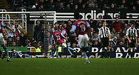 Photo: Andrew Unwin.<br />Newcastle Utd v Aston Villa. The Barclays Premiership.<br />03/12/2005.<br />Newcastle's goalkeeper, Shay Given, lies beaten as Aston Villa celebrate Gavin McCann (C) scoring the equaliser.