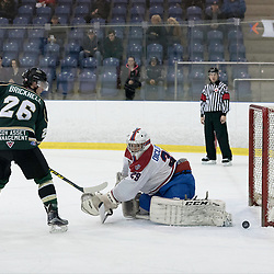 KINGSTON, ON - MAR 9,  2017: Ontario Junior Hockey League, playoff game between the Cobourg Cougars and Kingston Voyageurs, Boyd DiClemente #29 of the Kingston Voyageurs gets a piece of the shot from Jake Bricknell #26 of the Cobourg Cougars during the 2nd period.<br /> (Photo by Ian Dixon/ OJHL Images)