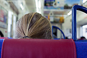 back of woman sitting in a train