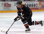 - Lincoln, Neb. 4/26/2003 River City Lancers John Togiai advances the puck down the ice..(Chris Machian/Prairie Pixel Group)