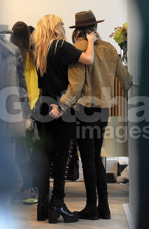 Singer Ellie Goulding and boyfriend Dougie Poynter out shopping at various shops, Victoria Beckham store, Chloe store, Acne store in London, UK. 26/09/2014<br /> BYLINE MUST READ : GOTCHAIMAGES.COM<br /> <br /> Copyright by &copy; Gotcha Images Ltd. All rights reserved.<br /> Usage of this image is conditional upon the acceptance <br /> of Gotcha Images Ltd, terms and conditions available at<br /> www.gotchaimages.com