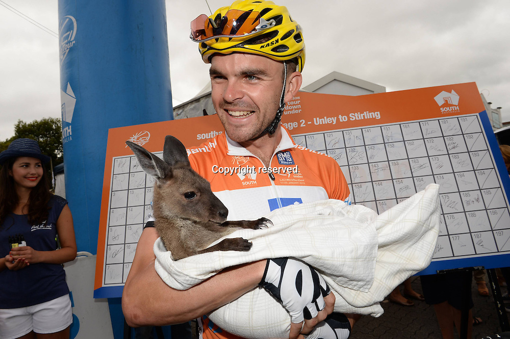 21.01.2015. Unley to Stirling. Tour Down Under cycling tour.  Unisa Australia 2015, Bobridge Jack holds a baby kangaroo in Unley