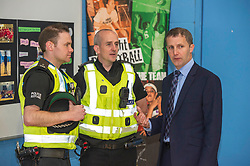 Pictured: Michael Matheson meets PC Ross Munro (l) and Gordon Currie (r)<br /> Today, Justice Secretary Michael Matheson visited the Raploch community campus and met young people involved in CashBack-funded basketball sessions. <br />  <br /> Ger Harley | EEm 11 July  2017