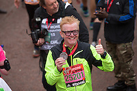 BBC Radio 2 disc jockey Chris Evans with his medal at the finishing line for the Virgin Money London Marathon, Sunday 26th April 2015.<br /> <br /> Scott Heavey for Virgin Money London Marathon<br /> <br /> For more information please contact Penny Dain at pennyd@london-marathon.co.uk