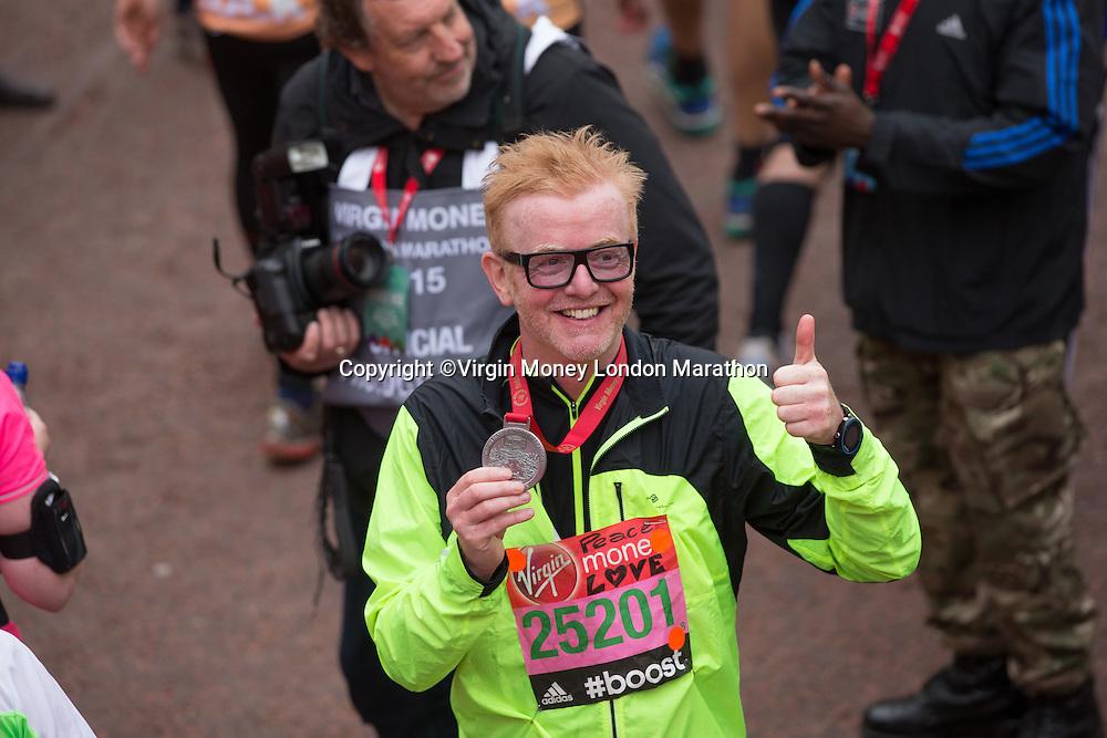 BBC Radio 2 disc jockey Chris Evans with his medal at the finishing line for the Virgin Money London Marathon, Sunday 26th April 2015.<br /> <br /> Scott Heavey for Virgin Money London Marathon<br /> <br /> For more information please contact Penny Dain at pennyd@london-marathon.co.uk
