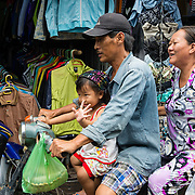 Family travelling by motorbike in Ho Chi Minh City
