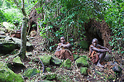 The traditional Batwa pygmies from the Bwindi Impenetrable Forest in Uganda. With the help of the Batwa Development Program they have re-created a village in the forest on land they now own. They were indigenous forest nomads before they were evicted from the Bwindi Impenetrable Forest in the mid nineties when it was made a World Heritage site to protect the mountain gorillas.