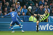 Huddersfield Town defender Christopher Schindler (26) kicks the ball over his head to clear the danger down Huddersfield Town's left wing as Kieran Lee (Sheffield Wednesday) looks on during the EFL Sky Bet Championship play off second leg match between Sheffield Wednesday and Huddersfield Town at Hillsborough, Sheffield, England on 17 May 2017. Photo by Mark P Doherty.