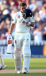 Joe Root of England kisses the badge on his helmet in celebration of reaching 100 - Mandatory by-line: Robbie Stephenson/JMP - 17/08/2017 - CRICKET - Edgbaston - Birmingham, England - England v West Indies - Investec Test Series