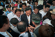 Tokyo - August 23th 2009 -  Yukio Hatoyama (C), president of Democratic Party of Japan (DPJ) and favorite for the seat of Prime Minister after the next general election, shakes hands after a street speech to support the DPJ local candidate in the Tokyo Yanaka area, Yoshikatsu Nakayama.