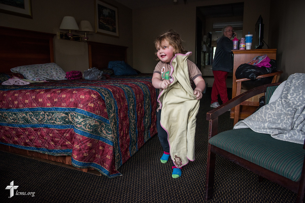 Madalynn Prichard plays at a motel on Monday, May 1, 2017, as her grandmother Patsy and mother Amanda (pictured) unpack in Eureka, Mo. Local LCMS congregations and LCMS Disaster Response are assisting the Lutheran family who have been displaced due to rising flood waters. LCMS Communications/Erik M. Lunsford
