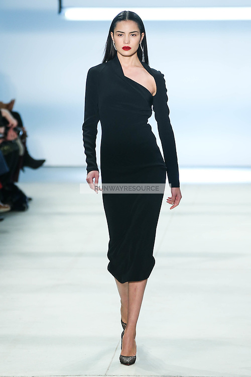 Irina Sharipova walks the runway wearing Cushnie et Ochs Fall 2016, hair by Antonio Corral Calero for Moroccanoil, makeup by Val Garland, photographed by Thomas Concordia during New York Fashion Week on February 12, 2016