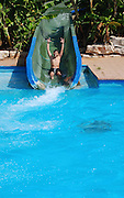 Young boy on a water slide