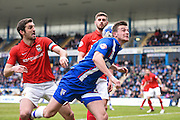 Gillingham forward Rory Donnelly challenges for the ball in the penalty area under pressure from Coventry defender Sam Ricketts (captain) during the Sky Bet League 1 match between Gillingham and Coventry City at the MEMS Priestfield Stadium, Gillingham, England on 2 April 2016. Photo by David Charbit.