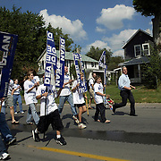 Presidential candidate Howard Dean runs along side his supporters during a Labor Day parade through the streets of Des Moines, Ia., in 2003.  Dean, who led in the polls for much of the pre-caucus political season in Iowa, finished a disappointing third place, all but ending his presidential bid.  Dean is currently chairman of the Democratic Party.