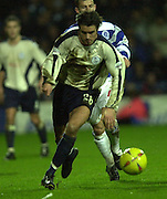 29/11/2003 - Photo  Peter Spurrier.2003/04 Nationwide Football Div 2 QPR V Sheffield Wed.Wednesday's Michael Reddy attacks down the wing.