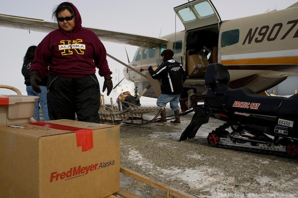 May 1, 2008 -- Kivalina, AK, U.S.A..Unloading a plane of supplies in Kivalina, Alaska. (Photo by Tim Matsui)