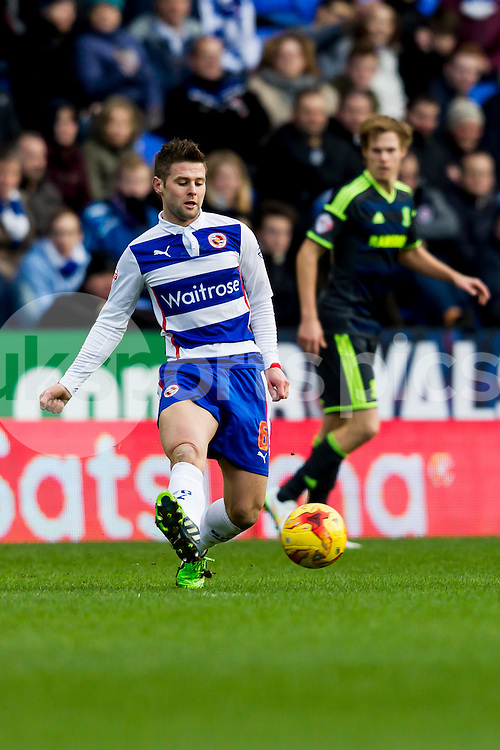 Oliver Norwood of Reading passes the  ball during the Sky Bet Championship match between Reading and Middlesbrough at the Madejski Stadium, Reading, England on 10 January 2015. Photo by Gareth  Brown.