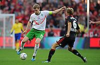 FUSSBALL   1. BUNDESLIGA   SAISON 2011/2012    2. SPIELTAG Bayer 04 Leverkusen - SV Werder Bremen              14.08.2011 Per MERTESACKER (li, Bremen) gegen Simon ROLFES (re, Leverkusen)