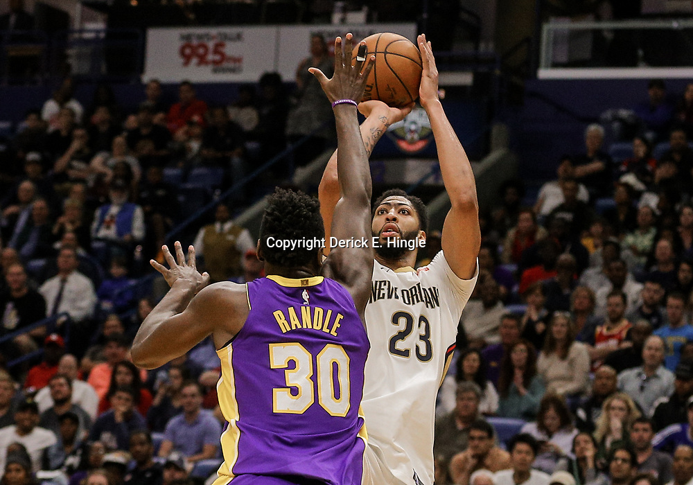 Mar 22, 2018; New Orleans, LA, USA; New Orleans Pelicans forward Anthony Davis (23) shoots over Los Angeles Lakers forward Julius Randle (30) during the second half at the Smoothie King Center. The Pelicans defeated the Lakers 128-125. Mandatory Credit: Derick E. Hingle-USA TODAY Sports