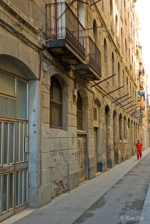The walker in red, Raval, Barcelona, Spain