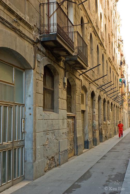 The walker in red, Raval, Barcelona, Spain