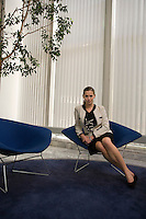 Business woman sitting in office lobby portrait