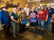 08 JULY 2019 - CRESTON, IOWA: Former Governor JOHN HICKENLOOPER (D-CO), center, poses for a photo with Iowa voters who attended his campaign meet and greet in Creston. Hickenlooper is running to be the Democratic nominee in the 2020 Presidential election. At least five staffers left Hickenlooper's campaign last week, including his campaign manager, communications director, digital director and finance director. Hickenlooper named M.E. Smith, who worked on Hickenlooper's successful reelection as Colorado Governor in 2014, as his campaign manager on July 1. Iowa is the first state to hold a presidential selection event in the 2020 election cycle. The Iowa caucuses are February 3, 2020.               PHOTO BY JACK KURTZ