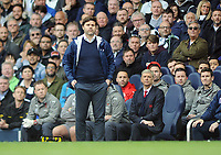 Football - 2016 / 2017 Premier League - Tottenham Hotspur vs. Arsenal<br /> <br /> Arsenal Manager Arsene Wenger looks over the shoulder of Tottenham Manager Mauricio Pochettino shouts at his players at White Hart Lane.<br /> <br /> COLORSPORT/ANDREW COWIE