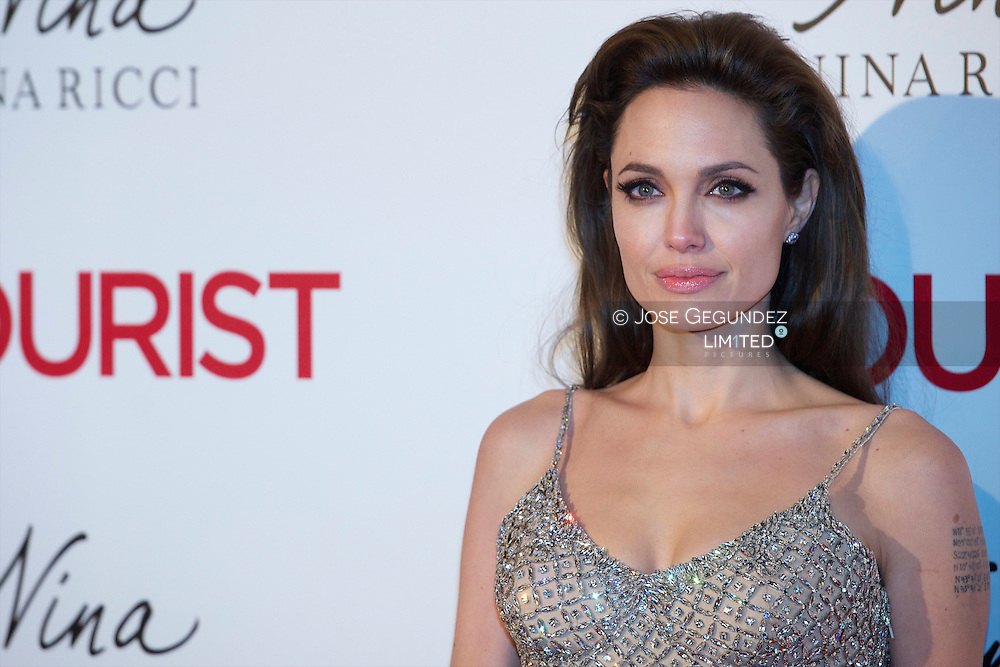 "(FILES) December 16, 2010 file photo shows US actress Angelina Jolie posing as she arrives for the premiere of her last film ""the Tourist"" at the Palacio de Deportes of Madrid. Angelina Jolie revealed mAY 14, 2013 that she has undergone a preventive double mastectomy to reduce her risk of cancer. The American actress wrote in an opinion piece entitled ""My Medical Choice"" in The New York Times that she had chosen the procedure because she carries a faulty gene that increases her risk of breast and ovarian cancer."