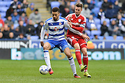 Reading FC defender Michael Hector holding off Cardiff City midfielder Anthony Pilkington during the Sky Bet Championship match between Reading and Cardiff City at the Madejski Stadium, Reading, England on 19 March 2016. Photo by Mark Davies.