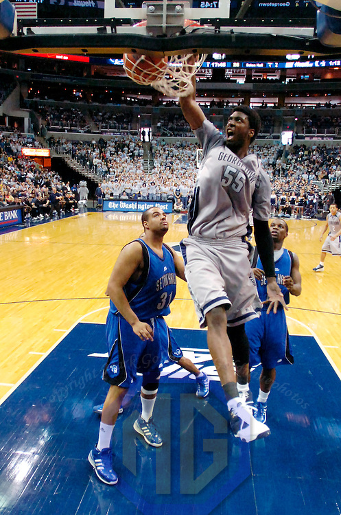 02 February 2008:   Georgetown University Hoyas center Roy Hibbert (55) slams in 2 of his 16 points against Seton Hall Pirates forward John Garcia (31) in the second half at the Verizon Center in Washington, D.C.  The Hoyas defeated the Seton Hall Pirates 73-61.