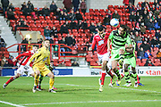 Forest Green Rovers Darren Carter(12) heads the ball during the Vanarama National League match between Wrexham FC and Forest Green Rovers at the Racecourse Ground, Wrexham, United Kingdom on 26 November 2016. Photo by Shane Healey.